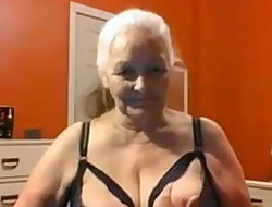 Grandma 68 years demonstrates big tits and pussy