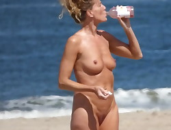 Mature Mummy naked on the beach